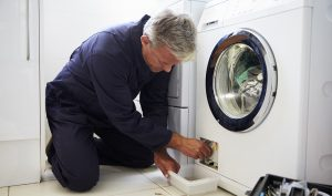 plumber-fixing-washing-machine